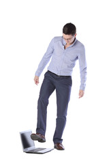 man comes on foot laptop isolated on white background