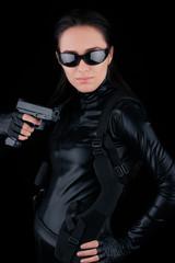 Woman Spy Holding Gun