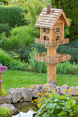 Homemade bird house in the garden