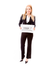 Businesswoman holding a vote placard