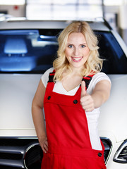Apprentices for car mechanic shows thumb up