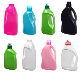 different plastic bottles of cleaning products on white
