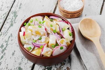 Potato salad with radishes and onions