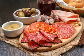 Antipasto with salami, cheese, bread and olives