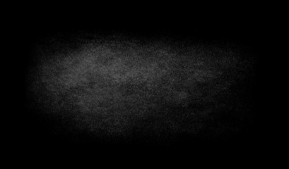 Black texture background with spotlight.