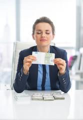 Business woman enjoying having money
