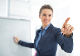 Business woman near flipchart pointing