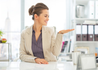 Business woman presenting something on empty palm