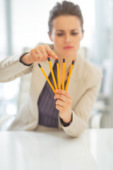 Closeup on business woman pointing on pencils