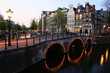 Amsterdam canals lit up at dusk, Netherlands