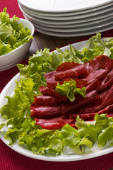 "Italian meal called ""bresaola"" with green salad"