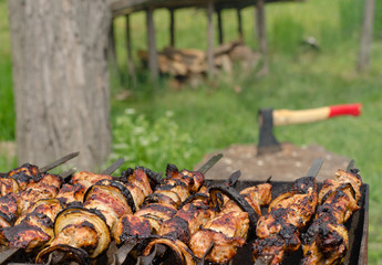 Kebabs sizzling over a hot BBQ fire