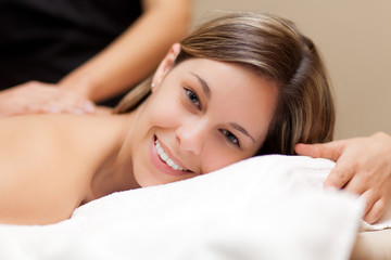 Smiling woman having a massage