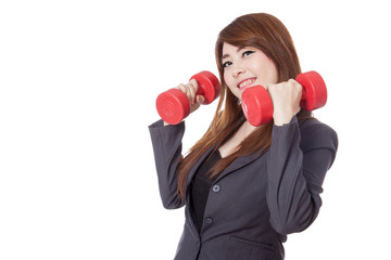 Asian businesswoman hold drumbbells with her both hand