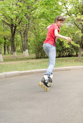 Young teenage girl skating on roller blades