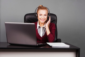 smiling beautiful call center operator with headphones