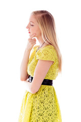 Side profile of a young woman thinking