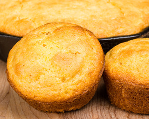 Cornbread muffins and cornbread pone in an iron skillet