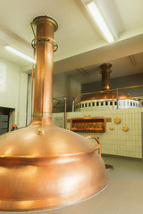 Boiling kettle and mash tun in the background.