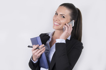 Smiling business woman making a call - smartphone - notebook