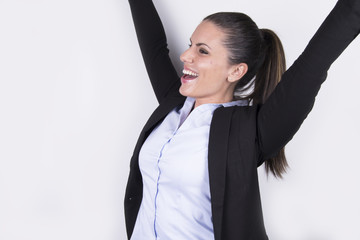 Happy beautiful business woman raising her hands