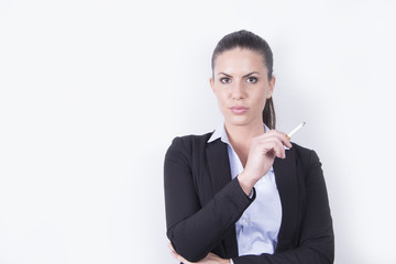 Business woman in a suit smoking a cigarette