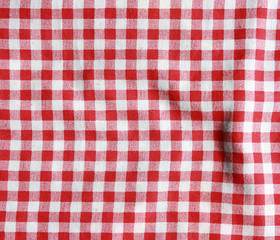 Red and white texture of a checkered picnic blanket.