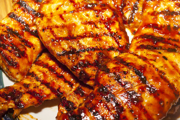 A close up on grilled barbecue chicken breasts
