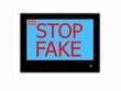 Slogan STOP FAKE  on television screen