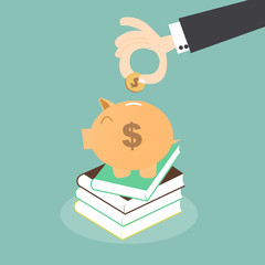 Saving for Education - Piggy Bank over Stack of Books