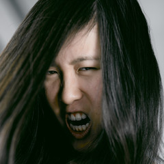 Ugly scary asian woman monster shouting desperate