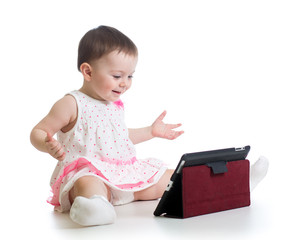 kid girl playing with a digital tablet