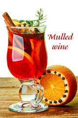 Mulled wine decorated with cinnamon sticks