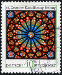 stamp shows the Rose Window, Freiburg Cathedral