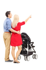 Mother and father pushing a baby stroller
