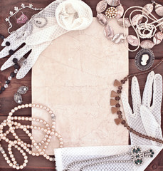 Frame with old women's jewelry and lacy white gloves