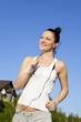 runner - woman running outdoors training for marathon run.