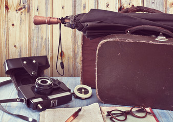 Old suitcases and a camera. Set traveler. Retro concept