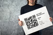 Man holding QR code business card