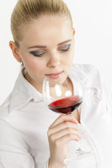 portrait of young woman drinking red wine