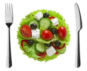 Greek salad plate with fork and knife