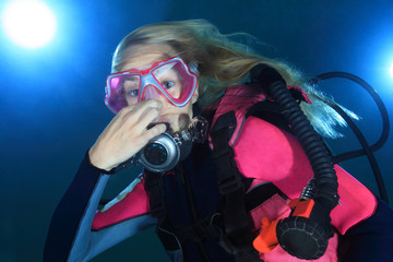 Female scuba diver making pressure relase