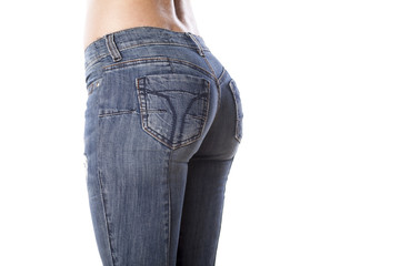 beautiful female buttocks in tight jeans
