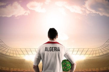 Algeria football player holding ball
