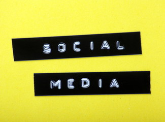 Social Media printed labels on a yellow background
