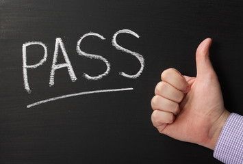 Pass Thumbs Up Sign on a Blackboard