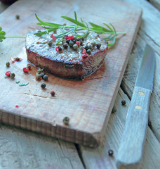 Beef steak with fresh rosemary and color pepper