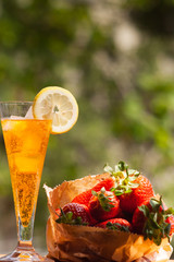 chilled drink with fresh strawberries in the summer outdoors