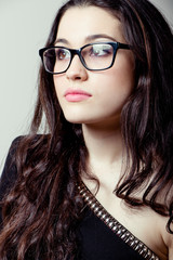 Beautiful girl with glasses portrait