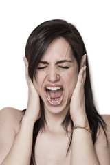Girl blocking ears with hands and screaming